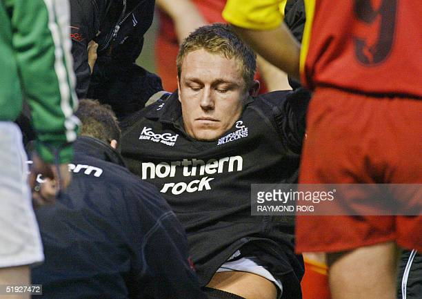 Newcastle flyhalf Jonny Wilkinson limps off the ground after being injured during their Rugby Union European cup match against Perpignan 08 January...