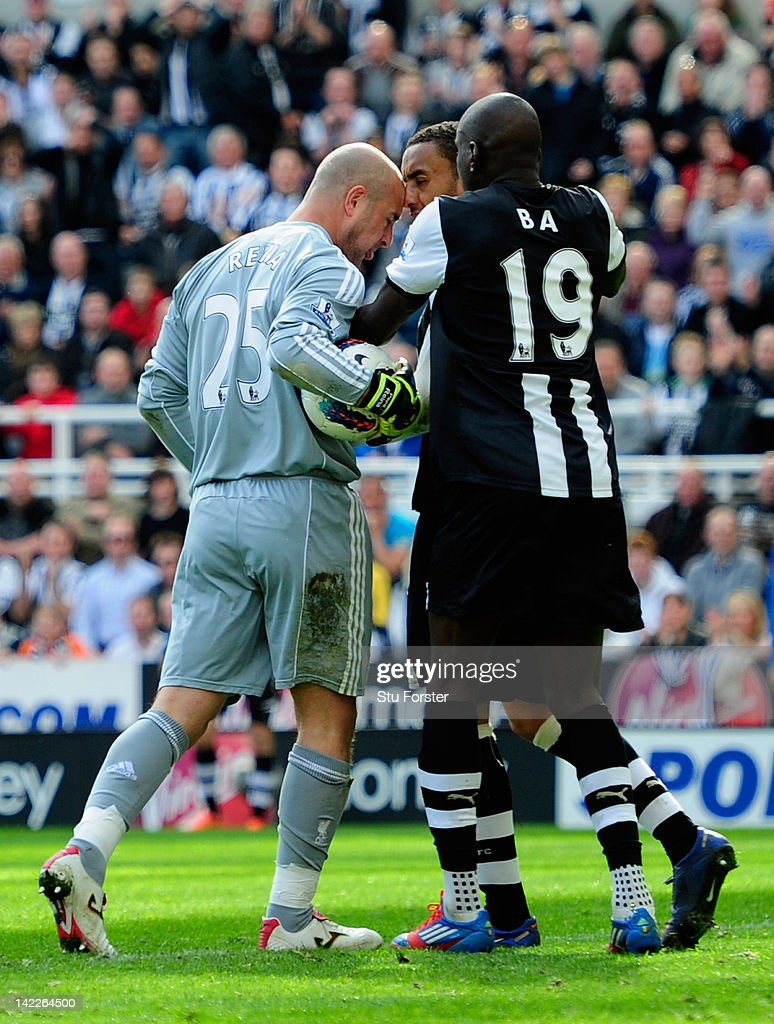 Newcastle forward Demba Ba (R) attempts to intervene as goalkeeper Pepe Reina of Liverpool allegedly head butts James Perch of Newcastle during the Barclays Premier League match between Newcastle United and Liverpool at Sports Direct Arena on April 1, 2012 in Newcastle upon Tyne, England.