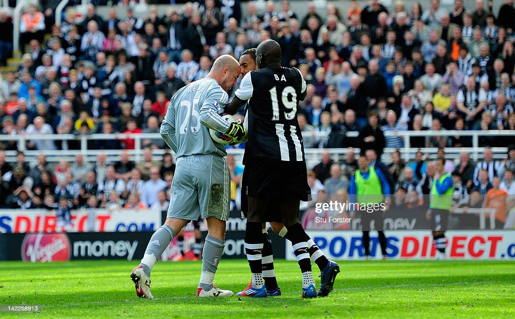 Newcastle forward Demba Ba (r) attempts to intervene as Liverpool keeper Pepe Reina allegedly head buts Newcastle defender James Perch during the Barclays Premier League match between Newcastle United and Liverpool at Sports Direct Arena on April 1, 2012 in Newcastle upon Tyne, England.