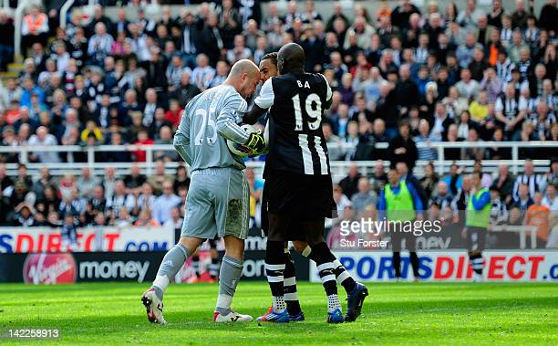Newcastle forward Demba Ba attempts to intervene as Liverpool keeper Pepe Reina allegedly head buts Newcastle defender James Perch during the...