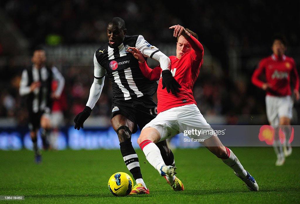 Newcastle forward Demba Ba is tackled by Phil Jones during the Barclays Premier league game between Newcastle United and Manchester United at St James' Park on January 4, 2012 in Newcastle upon Tyne, England.