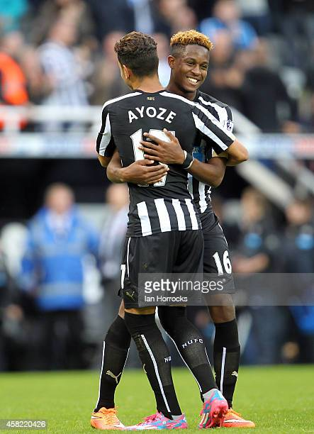 Newcastle goal scorer Ayoze Perez celebrates with Rolando Aarons during the Barclays Premier League match between Newcastle United and Liverpool at...