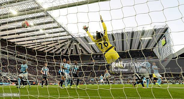 Newcastle goalkeeper Karl Darlow is beaten by a header from Sergio Aguero for the first goal during the Barclays Premier League match between...