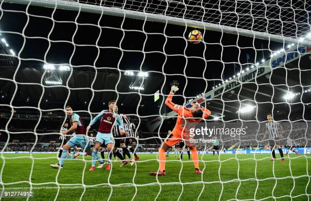 Newcastle goalkeeper Karl Darlow is beaten by a Sam Vokes header for the Burnley goal during the Premier League match between Newcastle United and...
