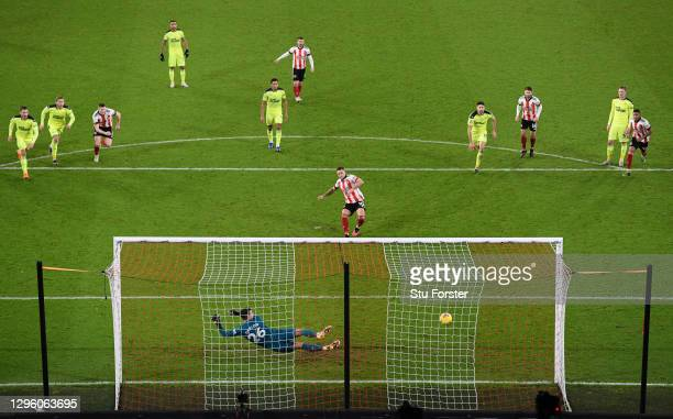 Newcastle goalkeeper Karl Darlow looks on as he is beaten by the penalty kick of Sheffield United striker Billy Sharp for the winning goal during the...