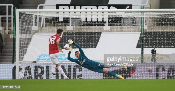 Newcastle goalkeeper Karl Darlow saves a penalty from Bruno Fernandes of Man Utd during the Premier League match between Newcastle United and...