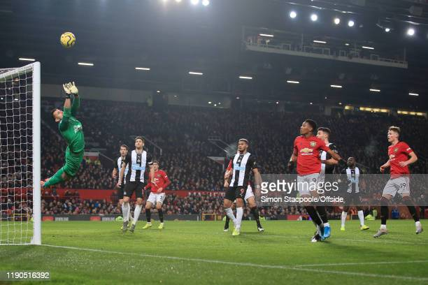 Newcastle goalkeeper Martin Dubravka dives to make a save during the Premier League match between Manchester United and Newcastle United at Old...