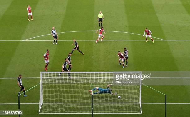 Newcastle goalkeeper Martin Dubravka is beaten by a shot from Arsenal player Mohamed Elneny for the first Arsenal goal during the Premier League...