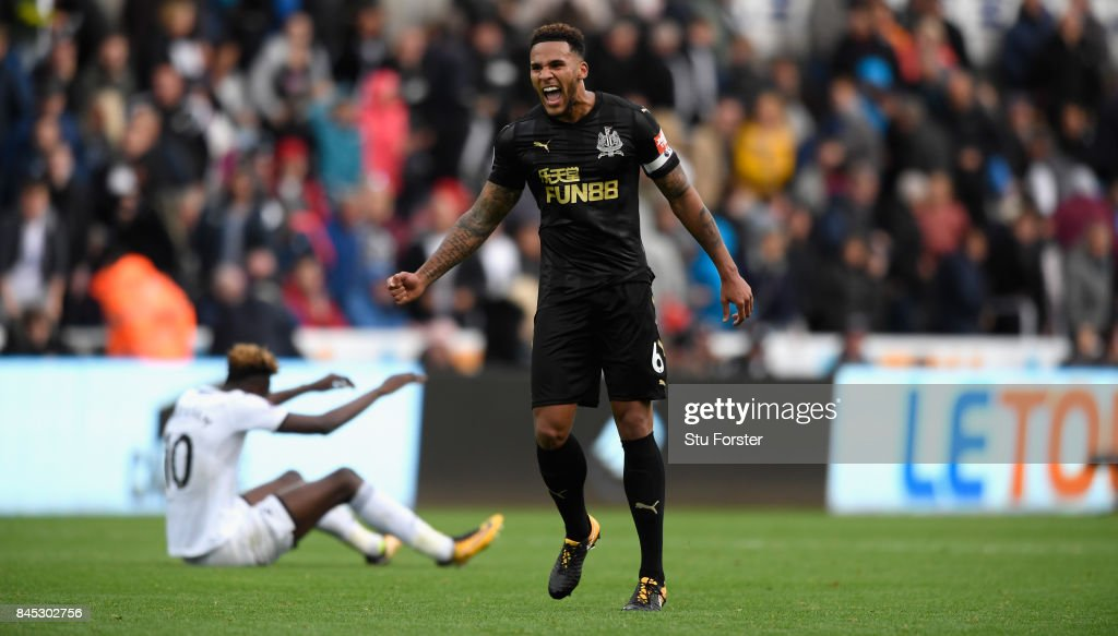 Newcastle goalscorer Jamaal Lascelles celebrates on the final whistle during the Premier League match between Swansea City and Newcastle United at Liberty Stadium on September 10, 2017 in Swansea, Wales.