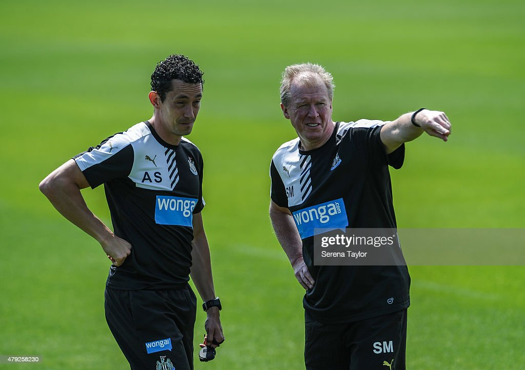 Newcastle Head Coach Steve McClaren talks to Fitness Coach Alessandro Schoenmaker stands on the pitch talking during the Newcastle United Pre-Season Training session at The Newcastle United Training Centre on July 1, 2015, in Newcastle upon Tyne, England.