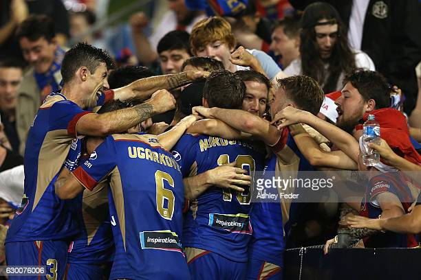 Newcastle Jets celebrate a goal during the round 11 ALeague match between the Newcastle Jets and Adelaide United at McDonald Jones Stadium on...
