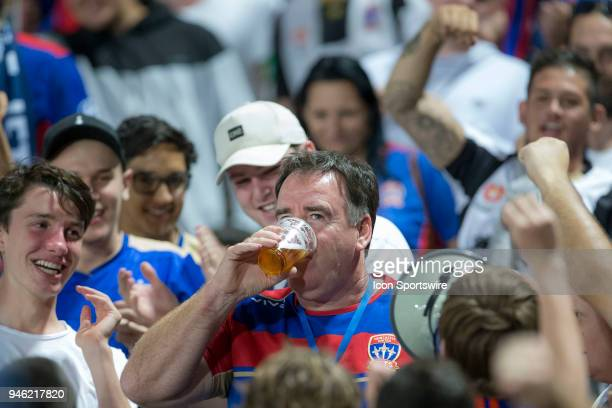Newcastle Jets CEO Lawrie McKinna enjoys a beer with fans at the ALeague Soccer Match between Central Coast Mariners and Newcastle Jets on April 14...
