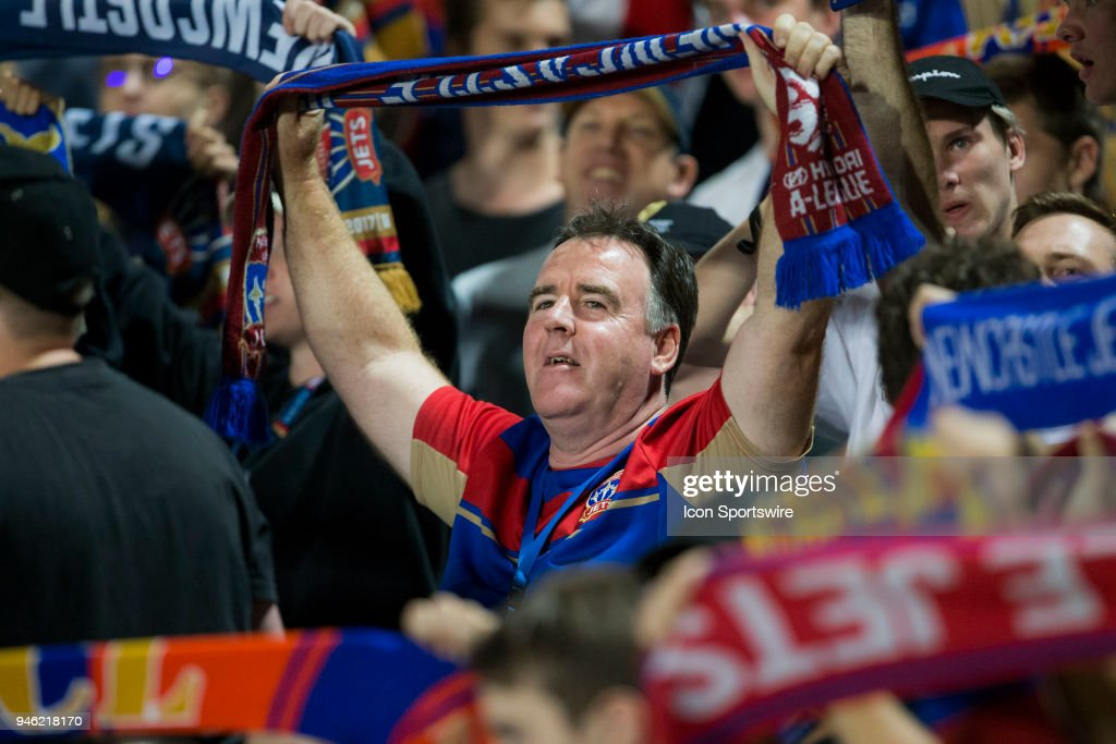 Newcastle Jets CEO Lawrie McKinna holds a scarf with fans at the A-League Soccer Match between Central Coast Mariners and Newcastle Jets on April 14, 2018 at Central Coast Stadium in Gosford, Australia.