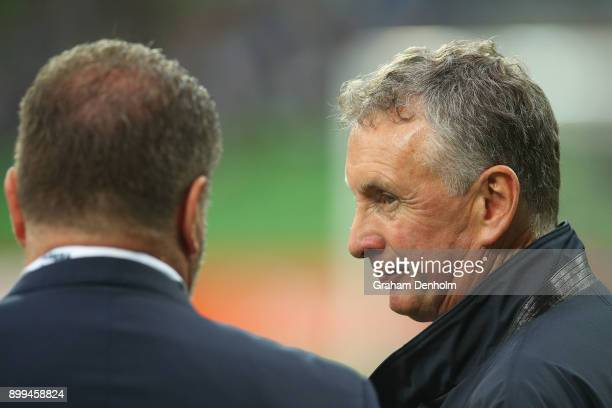 Newcastle Jets Head Coach Ernie Merrick talks to former Socceroos Head Coach Ange Postecoglou prior to the round 13 ALeague match between the...