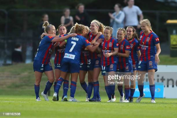 Newcastle Jets players celebrate a goal during the round 1 W-League match between the Newcastle Jets and Melbourne City at No. 2 Sportsground on...