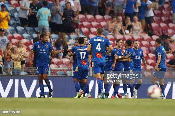 Newcastle Jets players celebrate a goal during the round 12 ALeague match between the Newcastle Jets and the Brisbane Roar at McDonald Jones Stadium...