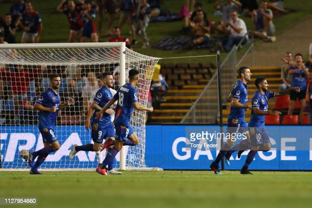 Newcastle Jets players celebrate a goal during the round 18 ALeague match between the Newcastle Jets and the Wellington Phoenix at McDonald Jones...
