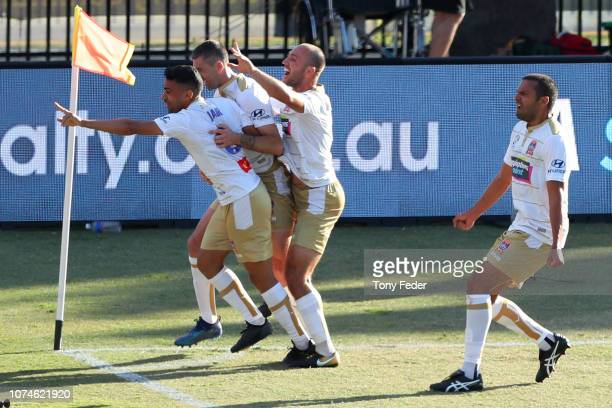 Newcastle Jets players celebrate a goal during the round nine ALeague match between the Central Coast Mariners and the Newcastle Jets at Central...