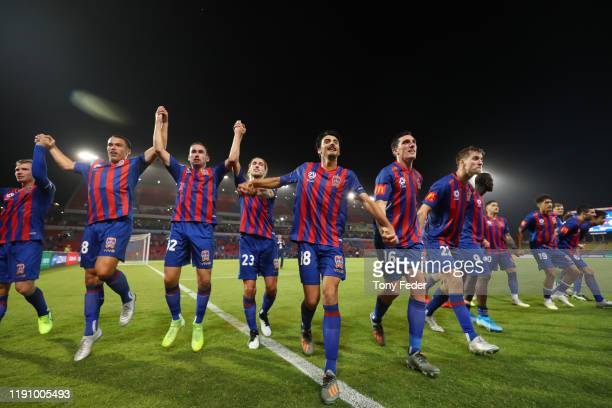 Newcastle Jets players celebrate after the game during the round eight A-League match between the Newcastle Jets and the Western Sydney Wanderers at...