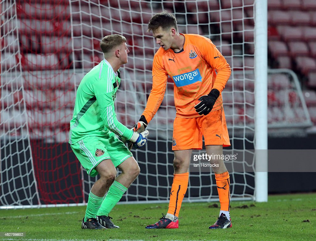 Newcastle keeper Freddie Woodman (R) consoles Sunderland keeper James Talbot of Newcastle after a penalty shoot out during the FA Youth Cup match between Sunderland U18 and Newcastle United U18 at The Stadium of Light on February 04, 2015 in Sunderland, England.