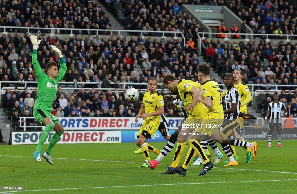 Newcastle keeper Karl Darlow (L) makes a save during the Sky Bet Championship match between Newcastle United and Burton Albion at St James' Park on April 5, 2017 in Newcastle upon Tyne, England.