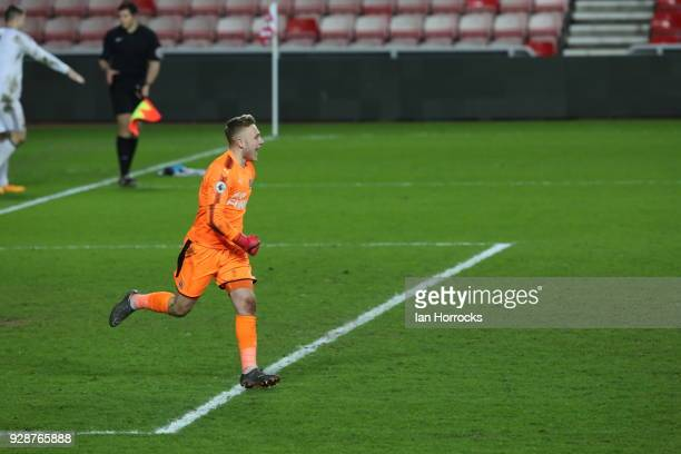 Newcastle keeper Paul Woolston celebrates winning the penalty shoot out during the Premier League International Cup match between Sunderland U23 and...