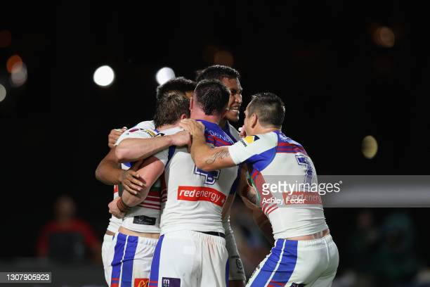 Newcastle Knights celebrate a try from Hymel Hunt during the round two NRL match between the New Zealand Warriors and the Newcastle Knights at...
