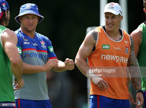 Newcastle Knights coach Nathan Brown with player Trent Hodkinson during a Newcastle Knights NRL preseason training session at Hunter Stadium on...