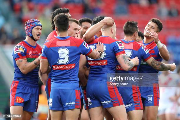 Newcastle Knights players celebrate a try during the round 19 NRL match between the Newcastle Knights and the St George Illawarra Dragons at McDonald...