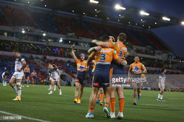 Newcastle Knights players celebrate the win over the Cowboys during the round 15 NRL match between the Newcastle Knights and the North Queensland...