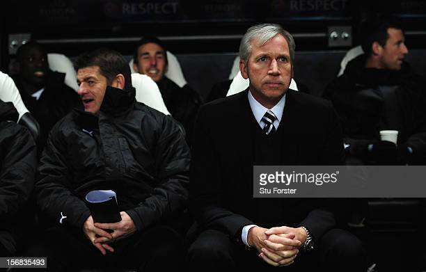 Newcastle manager Alan Pardew and coach John Carver look on before the UEFA Europa League Group match between Newcastle United FC and CS Maritimo at...