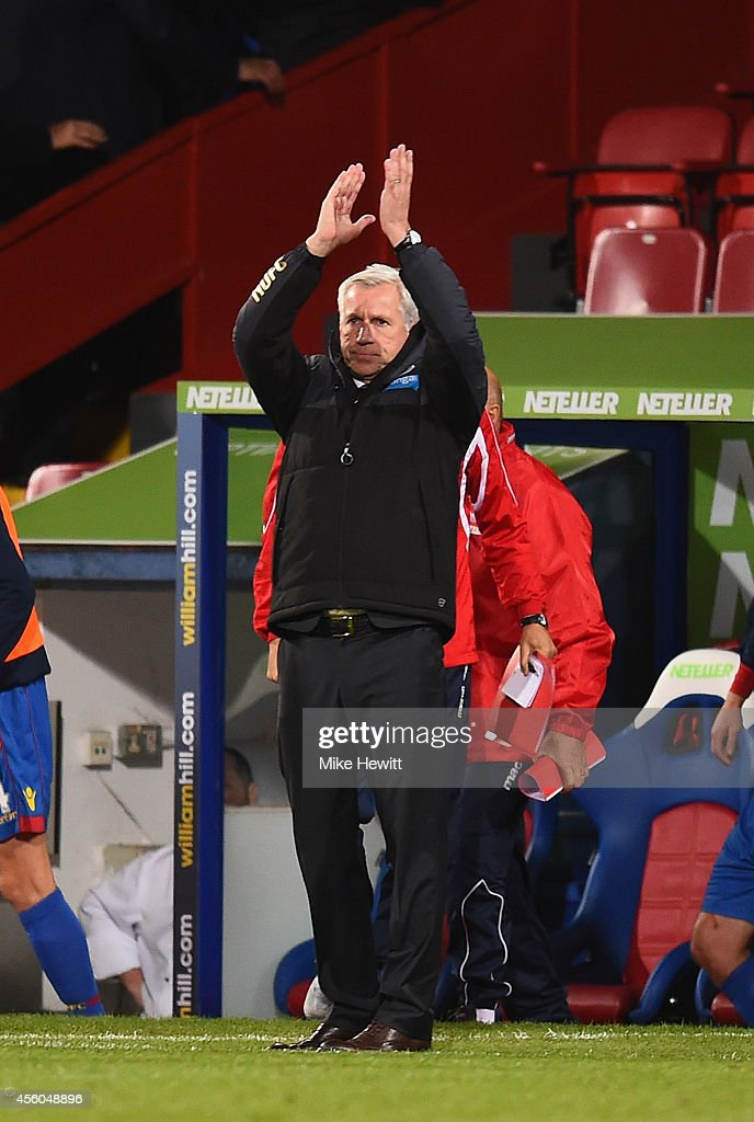 Newcastle manager Alan Pardew applauds the Newcastle fans at the end of the Capital One Cup Third Round match between Crystal Palace and Newcastle United at Selhurst Park on September 24, 2014 in London, England.