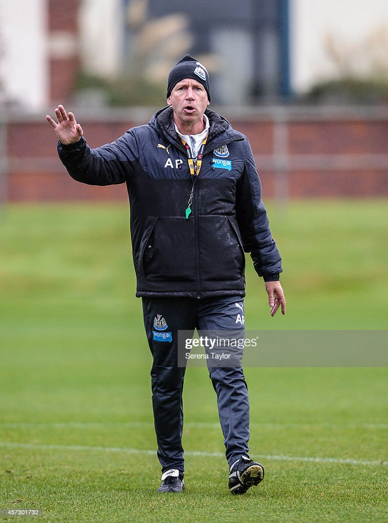 Newcastle Manager Alan Pardew holds his hand up whilst giving instructions on the training pitch during a training session at The Newcastle United Training Centre on October 16, 2014, in Newcastle upon Tyne, England.