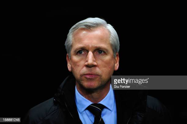 Newcastle manager Alan Pardew looks on before the Barclays Premier League match between Newcastle United and Everton at St James' Park on January 2...