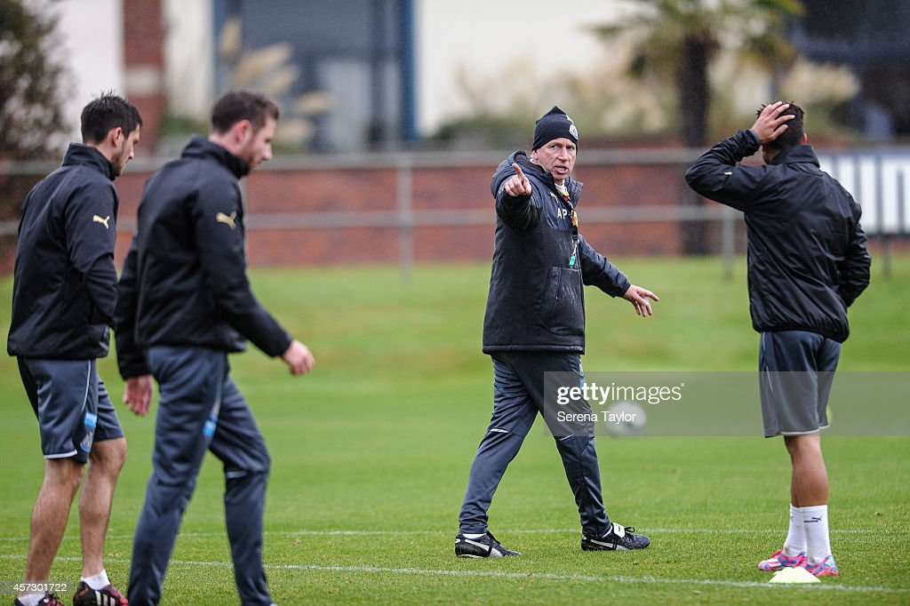 Newcastle Manager Alan Pardew points whilst giving instructions on the training pitch during a training session at The Newcastle United Training Centre on October 16, 2014, in Newcastle upon Tyne, England.