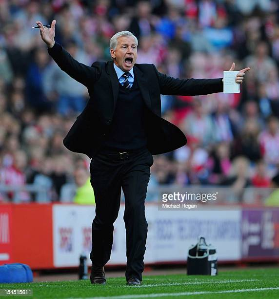 Newcastle manager Alan Pardew shouts instructions during the Barclays Premier League match between Sunderland and Newcastle United at the Stadium of...