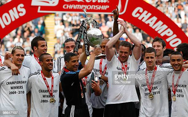 Newcastle manager Chris Hughton lifts the trophy as Newcastle are crowned champions of the Championship after the Coca Cola Championship match...