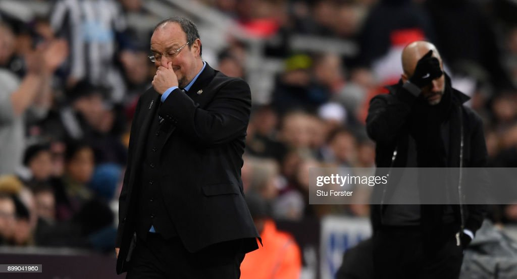 Newcastle manager Rafa Benitez (l) and Pep Guardiola react during the Premier League match between Newcastle United and Manchester City at St James' Park on December 27, 2017 in Newcastle Upon Tyne, England.