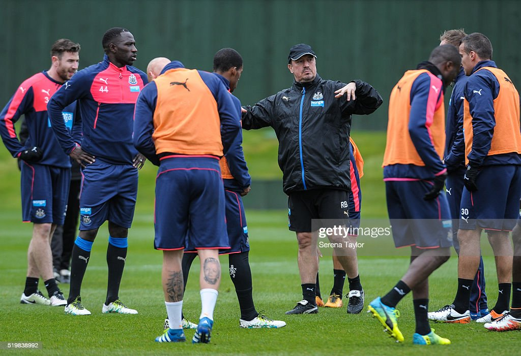 Newcastle Manager Rafael Benitez (C) talks to his players on the training pitch during the Newcastle United Training session at The Newcastle United Training Centre on April 8, 2016 in Newcastle upon Tyne, England.