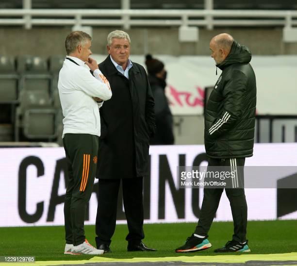 Newcastle manager Steve Bruce 9C speaks to Man Utd manager Ole Gunnar Solskjaer and Man Utd assistant Mike Phelan before the Premier League match...