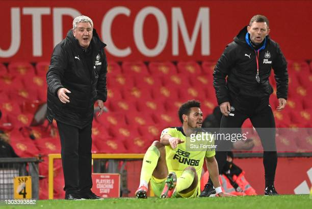 Newcastle manager Steve Bruce and coach Graeme Jones look on as 'striker Joelinton reacts after going to ground during the Premier League match...