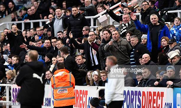 Newcastle manager Steve McClaren looks on as the home support suggest it may be time to go during the Barclays Premier League match between Newcastle...