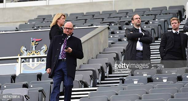 Newcastle managing director Lee Charnley look on as The new TV Screen delayings the opening of the turnstilles before the Barclays Premier League...