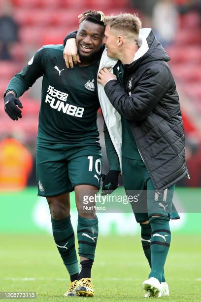 Newcastle midfielder Allan SaintMaximin scorer of the only goal laughs with teammate Matt Ritchie during the Premier League match between Southampton...