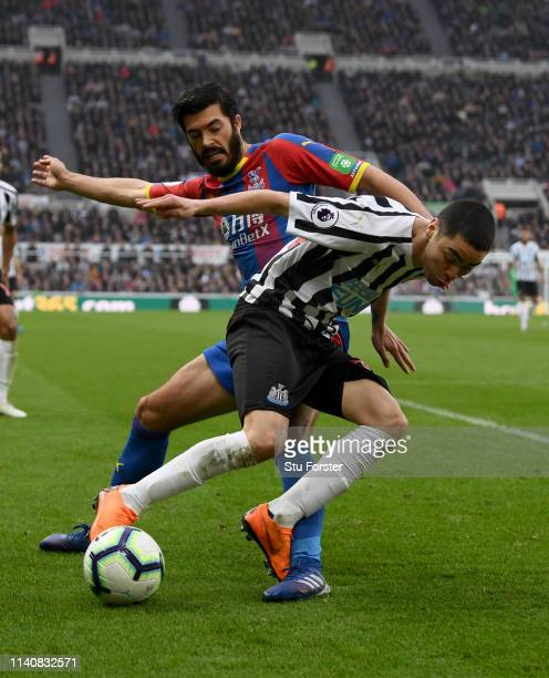 Newcastle Miguel Almiron is challenged by Palace player James Tomkins during the Premier League match between Newcastle United and Crystal Palace at...