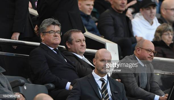 Newcastle owner Mike Ashley flanked by Keith Bishop and Lee Charnley look on from the stand during the Premier League match between Newcastle United...