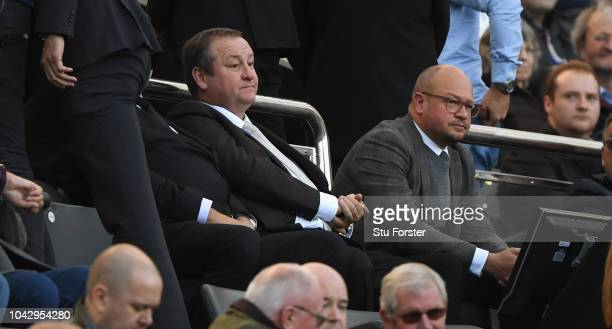 Newcastle owner Mike Ashley flanked by Lee Charnley look on from the stand during the Premier League match between Newcastle United and Leicester...