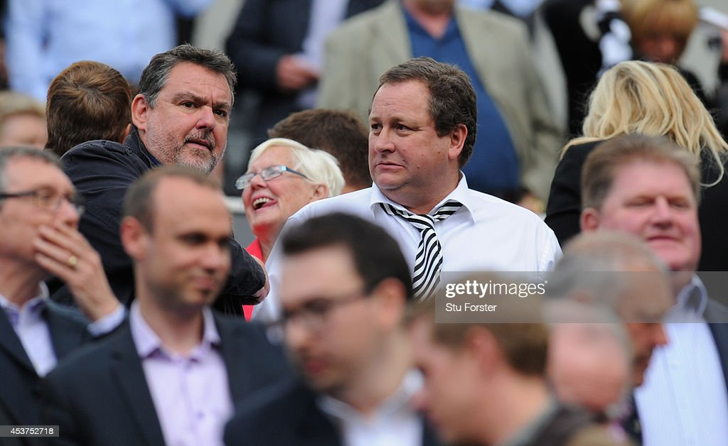 Newcastle owner Mike Ashley (c) looks on before the Barclays Premier League match between Newcastle United and Manchester City at St James' Park on August 17, 2014 in Newcastle upon Tyne, England.