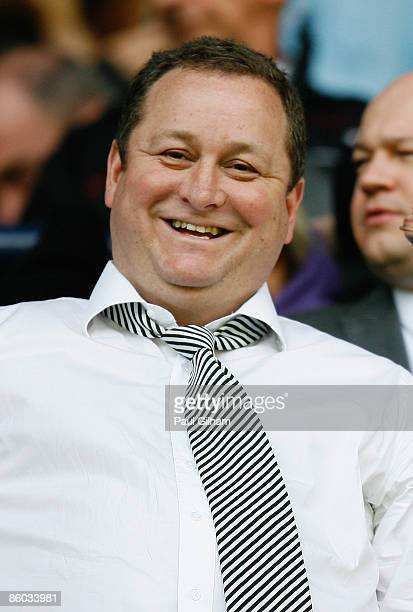 Newcastle owner Mike Ashley smiles during the Barclays Premier League match between Tottenham Hotspur and Newcastle United at White Hart Lane on...