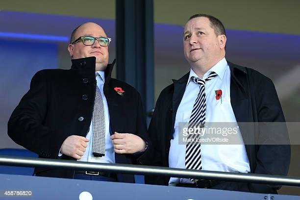Newcastle owner Mike Ashley stands alongside Managing Director Lee Charnley during the Barclays Premier League match between West Bromwich Albion and...